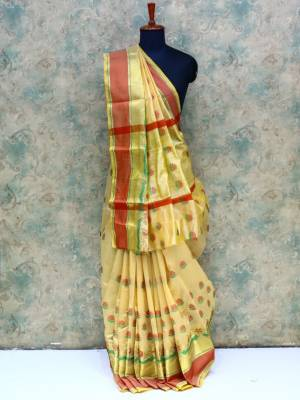 Cream  Colored Art Silk Traditional Saree With Golden And Rich Border And Pallu.